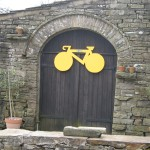 Yellow Bike for Tour de France on kart shed at High Blean B&B Raydale Askrigg