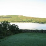 early morning mist over Semer Water, Askrigg Yorkshire Dales clearing
