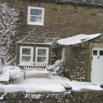 Photo of High Blean B&B Bainbridge, Askrigg showing snow on an outside bench.